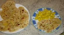 Pollo al curry con pan naan